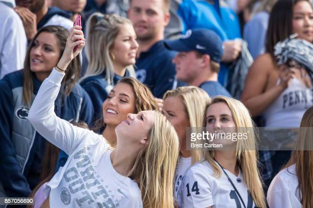 Penn State Nittany Lions student section fans take photos of the crowd during the game against the Indiana Hoosiers on September 30 2017 at Beaver...