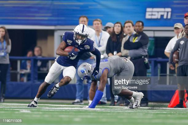 Penn State Nittany Lions wide receiver Jahan Dotson slips a tackle attempt by Memphis Tigers defensive back Sanchez Blake Jr during the Cotton Bowl...
