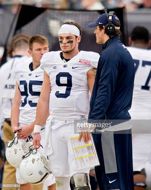 Penn State quarterback Christian Hackenberg right talks to quarterback Trace McSorley on the sidelines during the TaxSlayer Bowl on Saturday Jan 2 at...