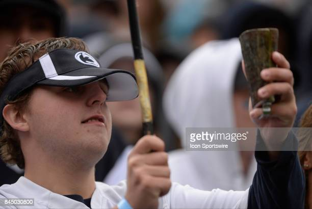 Penn State student fan plays hits a cow bell in the stands while wearing a visor The Penn State Nittany Lions defeated the Akron Zips 520 on...