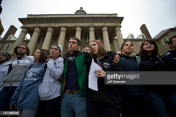 Penn State students gather at Old Main at the center of Penn State University's campus to express solidarity with the alleged rape victims following...