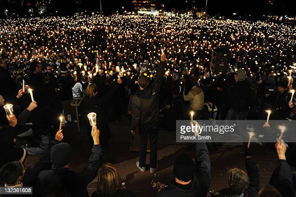 Penn State students hold candlelight vigil for abused victims in the Penn State scandal on Old Main Lawn November 11 2011 in State College...