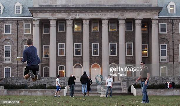 Penn State students play frisbee in front of Old Main on campus in the wake of the Jerry Sandusky scandal on November 11 2011 in State College...