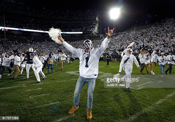 Penn State students rush the field after the Penn State Nittany Lions defeated the Ohio State Buckeyes 2421 on October 22 2016 at Beaver Stadium in...
