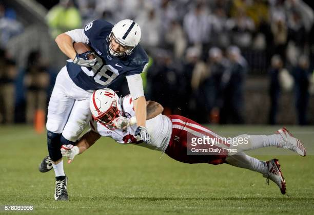 Penn State tight end Mike Gesicki dodges the tackle from a Nebraska defender Saturday Nov 18 2017 in State College Pa Penn State won over Nebraska...