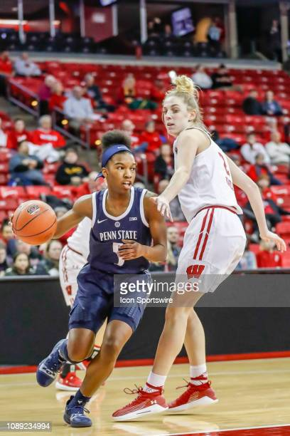 Penn State University guard Kamaria McDaniel works past Wisconsin guard Kelly Karlis during a women's college basketball game between the University...