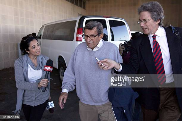Penn State University head football coach Joe Paterno is surrounded by the media while leaving the team's football building on November 8, 2011 in...