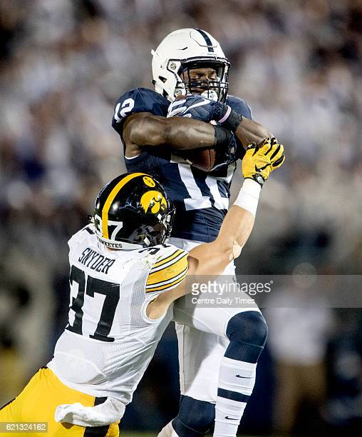 Penn State wide receiver Chris Godwin makes a catch around Iowa defensive back Brandon Snyder on Saturday Nov 5 at Beaver Stadium in State College Pa...