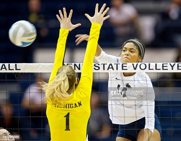 Penn State's Aiyana Whitney hits the ball past Michigan's Claire KiefferWright on Wednesday Nov 18 at Rec Hall in University Park Pa Michigan won 31