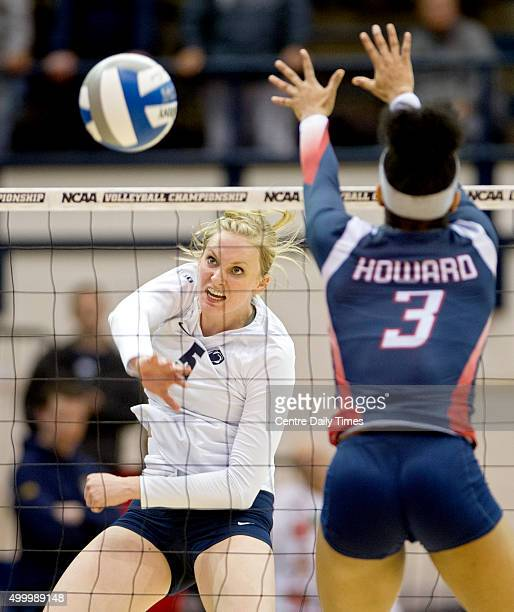 Penn State's Ali Frantti hits the ball past Howard's Dominique Cleggett during an NCAA women's volleyball tournament firstround match on Friday Dec 4...