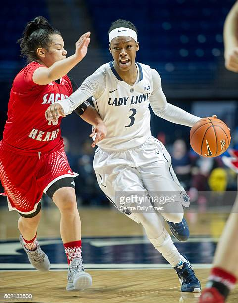 Penn State's Brianna Banks dribbles around a Sacred Heart defender on Sunday Dec 20 at the Bryce Jordan Center in University Park Pa Penn State won...