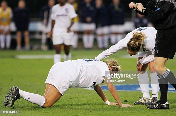 Penn State's Carmelina Moscato checks on injured teammate Allie Long during the 2005 NCAA Women's College Cup semifinal game between the Penn State...