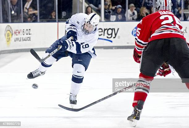 Penn State's Eric Scheid passes the puck past Ohio State's Justin DaSilva on Saturday March 15 at Pegula Ice Arena in State College Pa The Nittany...