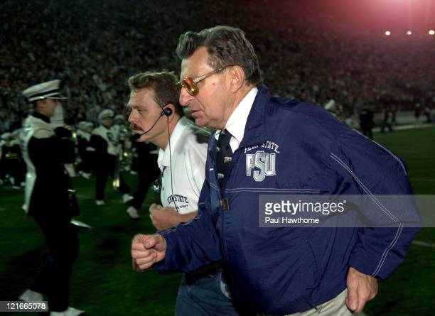 Penn State's Head Coach Joe Paterno runs off the field after Penn States loss to Ohio State at Beaver Stadium in University Park Pennsylvaina...
