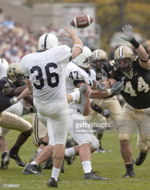Penn State's Jeremy Kapinos gets off a punt under pressure from Jon Goldsberry in the 1st quarter of Purdue's 2814 win over Penn State Oct 11 2003 in...
