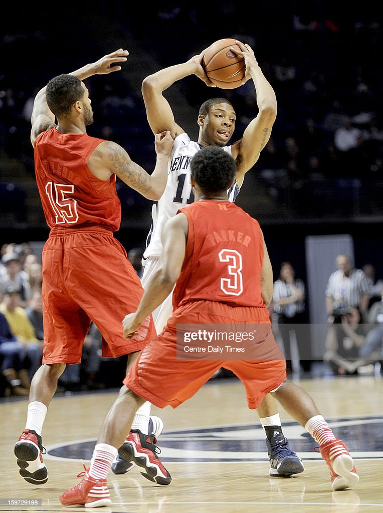 Penn State's Jermaine Marshall looks for an open teammate around Nebraska's Ray Gallegos and Benny Parker (3) on Saturday, January 19, 2013, at the Bryce Jordan Center in University Park, Pennsylvania. Nebraska pulled out a 68-64 victory.
