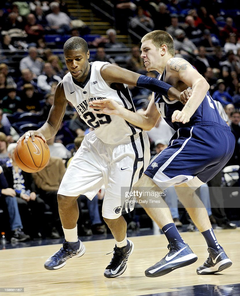 Penn State's Jon Graham drives around New Hampshire's Chris Pelcher during a men's college basketball game at the Bryce Jordan Center on Sunday, December 23, 2012, in State College, Pennsylvania.