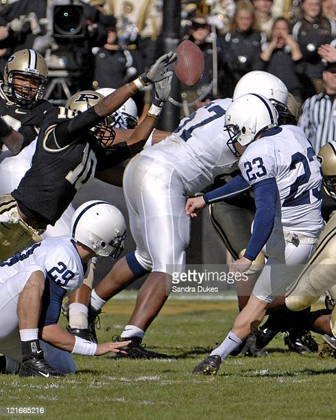Penn State's Kevin Kelly kicks a field goal with Kevin Suhey holding and Purdue's Royce Adams just missing the block in Penn State's 120 win over...
