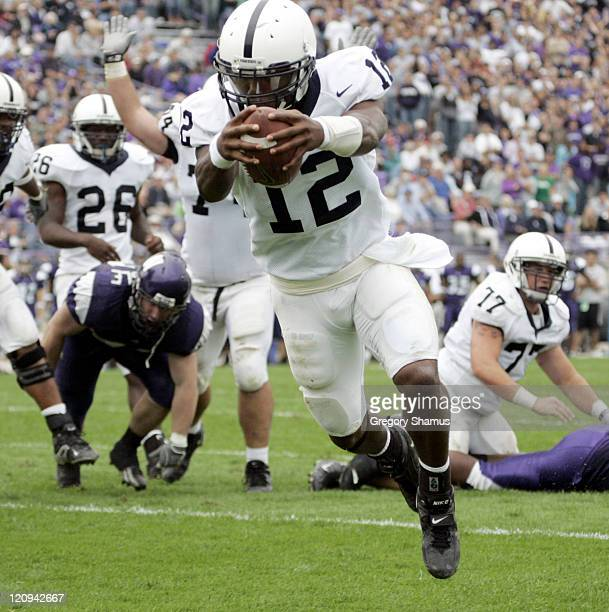 Penn State's Michael Robinson dives into the end zone for a fourth quarter touchdown versus Northwestern at Ryan Field in Evanston Illinois Sept 24...