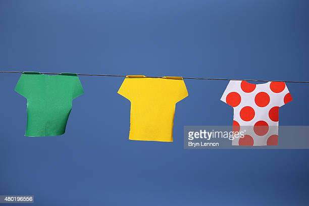 Pennants denoting the jerseys of the Tour de France hang above the streets at the start stage seven of the 2015 Tour de France a 1905km stage between...