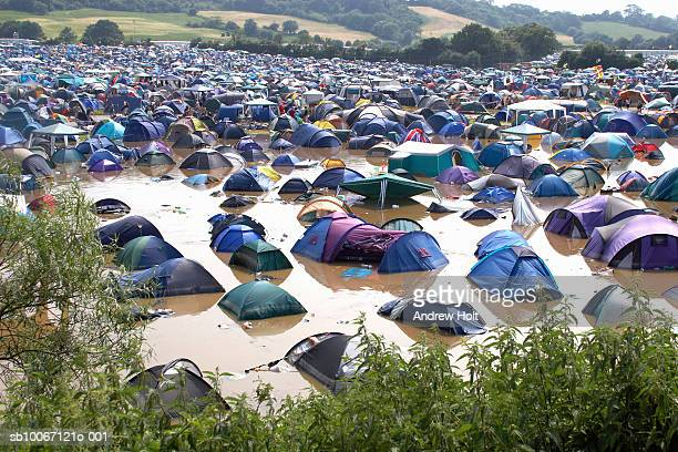 pennard hill camping field with tents in flooding at glastonbury festival - music festival stock pictures, royalty-free photos & images