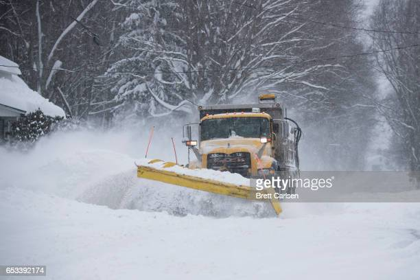 PennDOT plow trucks work to clear roads in northeastern Pennsylvania following snow fall up to two feet on March 14 2017 in Scranton City A blizzard...