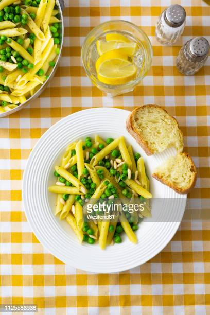 penne with peas and pine nuts, from above - salt and pepper shakers stock pictures, royalty-free photos & images