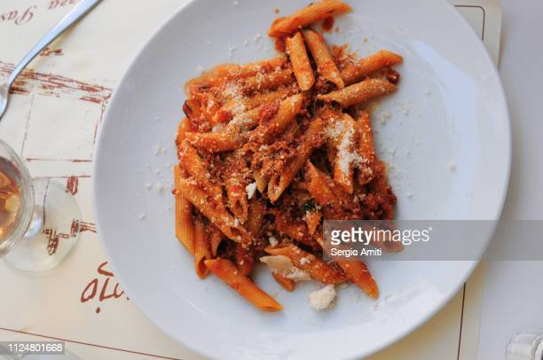 penne with ragout sauce - bolognese sauce stock pictures, royalty-free photos & images