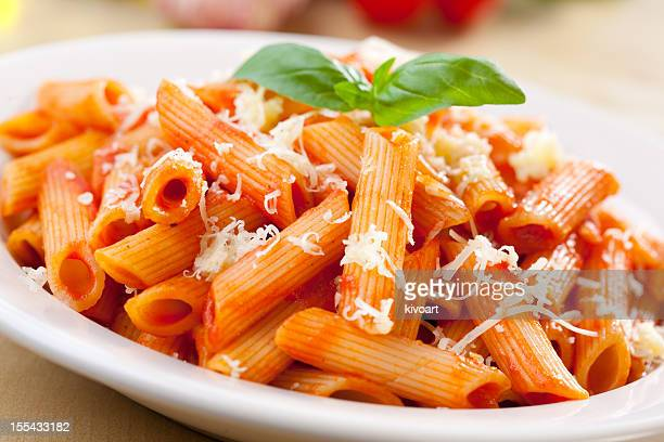 Penne with tomato sauce, basil and cheese on top