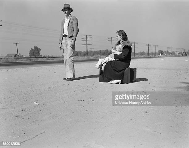 Penniless and Homeless Young Family Hitchhiking, U.S. Highway 99, California, USA, Dorothea Lange for Farm Security Administration, November 1936.