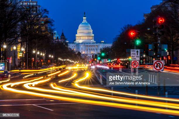 Pennsylvania Ave to US Capitol with Streaked lights going towards US Capitol in Washington DC during rush hour PM