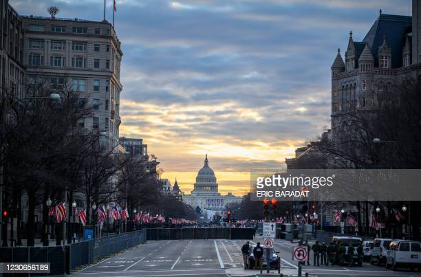 Pennsylvania Avenue with the Capitol in the background is seen under heavy security in the early hours of January 18, 2021 ahead of Joe Biden's...