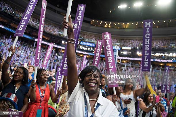Pennsylvania delegate Cherelle Parker cheers for Michelle Obama on the floor of the Wells Fargo Center in Philadelphia, Pa., on the first day of the...