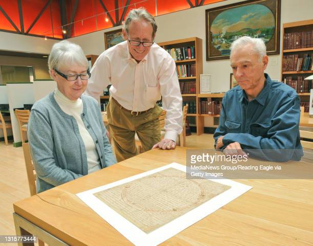 Pennsylvania German House Blessing Corinne and Russell Earnest look over the oldest known Pennsylvania German house blessing with Sime Bertolet,...