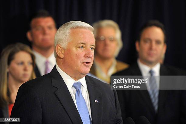 Pennsylvania Gov Tom Corbett speaks at a news conference to announce a lawsuit against the NCAA at the Nittany Lion Inn on the Penn State campus in...