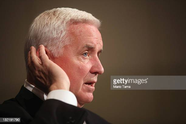 Pennsylvania Governor Tom Corbett listens to a question at a news conference following a night of rioting in response to the firing of head football...