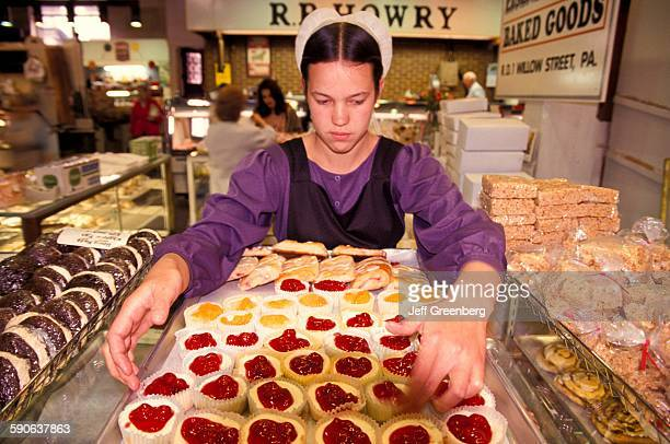 Pennsylvania Lancaster Central Market Amish Vendor with Tray Of CherryFilled Cheesecakes