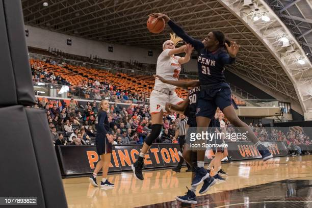 Pennsylvania Quakers center Eleah Parker blocks a shot during the second half of the college basketball game between the Penn Quakers and Princeton...