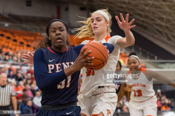 Pennsylvania Quakers center Eleah Parker drives to the basket during the first half of the college basketball game between the Penn Quakers and...