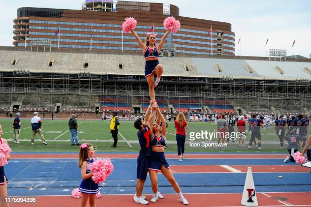 Pennsylvania Quakers cheerleaders make a pyramid during the game between the Sacred Heart Pioneers and the Penn Quakers on October 12, 2019 at...