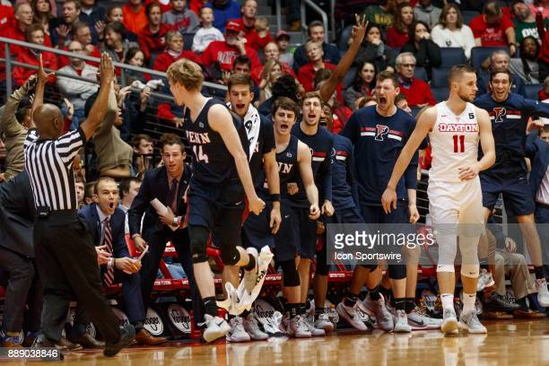 Pennsylvania Quakers forward Sam Jones and teammates react after making a three point shot during the second half of a game between the Dayton Flyers...