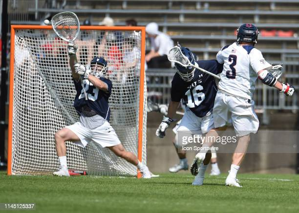 Pennsylvania Quakers Midfielder Tyler Dunn takes a shot at the goal during the Division I Men's Lacrosse Championship Quarterfinals game between the...