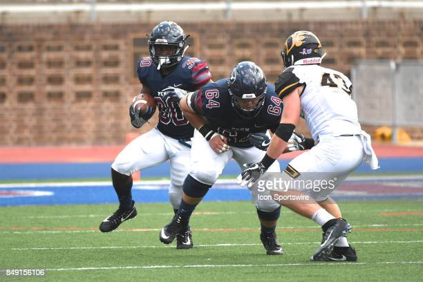 Pennsylvania Quakers offensive lineman Nathan Kirchmier lead blocks for Pennsylvania Quakers running back Karekin Brooks during a college football...