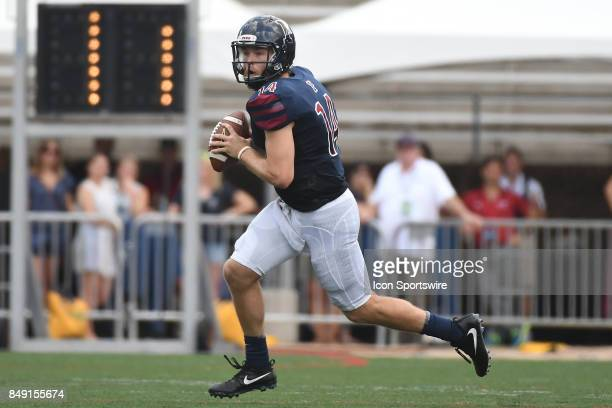 Pennsylvania Quakers quarterback Will FischerColbrie rolls out of the pocket during a college football game between the Penn Quakers and the Ohio...