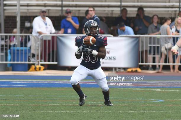 Pennsylvania Quakers running back Isaiah Malcolm fumbles the ball during a college football game between the Penn Quakers and the Ohio Dominican...