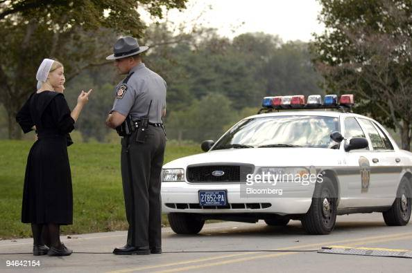 A Pennsylvania State Police Officer Speaks With Two Women