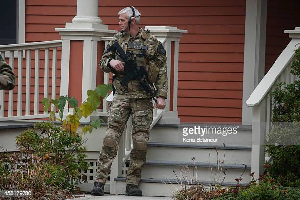 Pennsylvania State Police SWAT officer stands by as Eric Frein arrives at the Pike County Courthouse for his arraignment on October 31 2014 in...