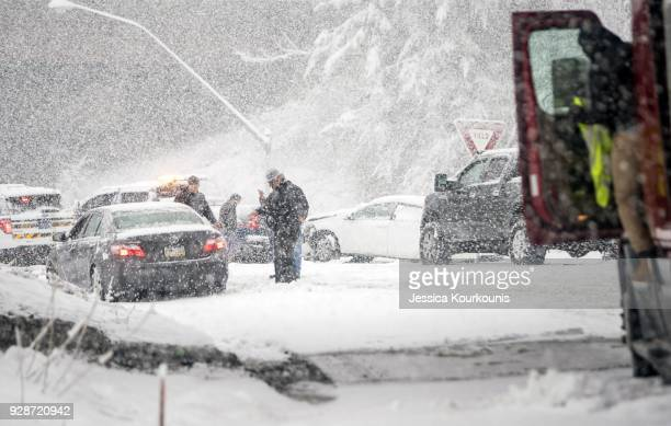 Pennsylvania State Troopers handle a car accident caused by winter weather on March 7 2018 along the Pennsylvania Turnpike in Philadelphia...