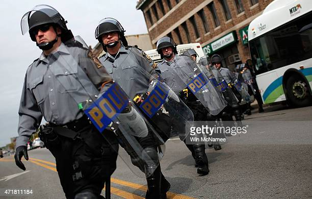 Pennsylvania State Troopers in riot gear deploy near the intersection of North Avenue and Pennsylvania Avenue May 1 2015 in Baltimore Maryland...