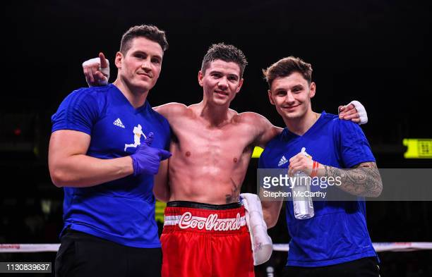 Pennsylvania , United States - 15 March 2019; Luke Campbell celebrates with his coach Shane McGuigan, left, and Josh Pritchard after winning his...